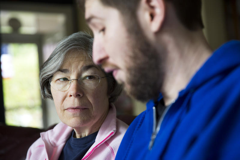 Alice Beaty watches her son Adam work on speech exercises at their home in Bellingham, Wash., on March 27, 2015. Adam is recovering from a severe car accident. It was initially unclear if he would survive.