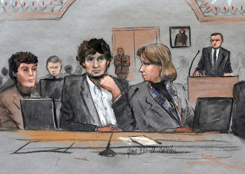 In this courtroom sketch, Dzhokhar Tsarnaev, center, is depicted between defense attorneys Miriam Conrad, left, and Judy Clarke, right, during his federal death penalty trial, Thursday, March 5, 2015, in Boston. Tsarnaev is charged with conspiring with hi