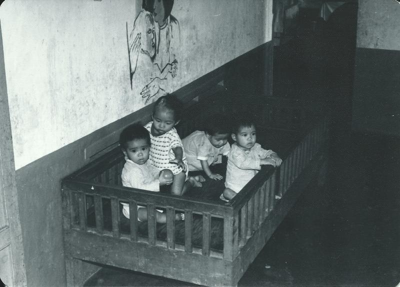 Orphans at the Ghenh Rang Orphanage in South Vietnam before Operation Babylift. Julie Davis, who lives in Minneapolis, belies that's her looking at the camera.