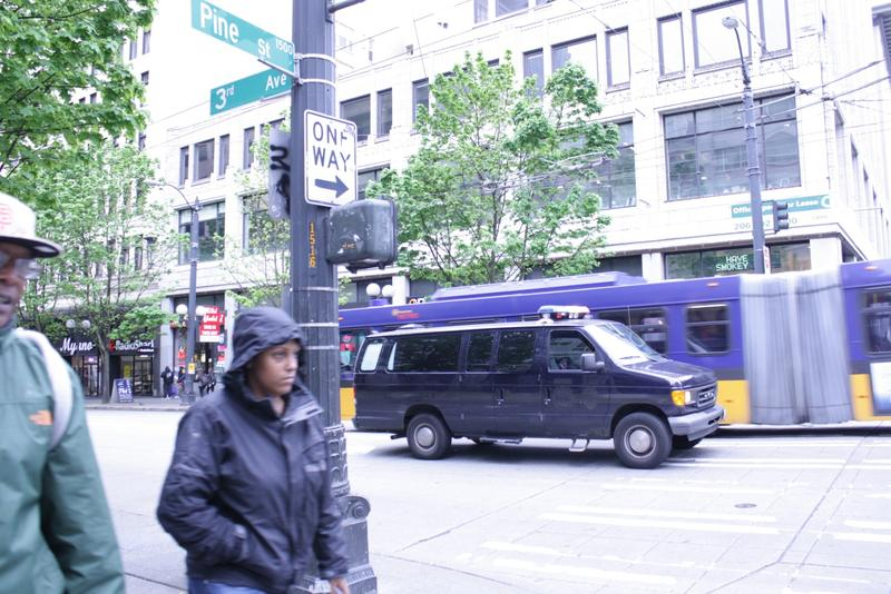 A police van at Third Avenue and Pine Street in downtown Seattle.
