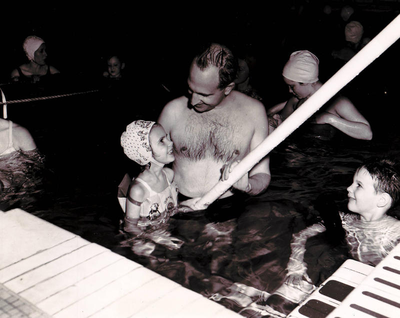 Kathy Parrish as a child with her father, George Dean, at the YWCA pool in Seattle. The pool would be heated to a higher degree for polio patients at certain times.