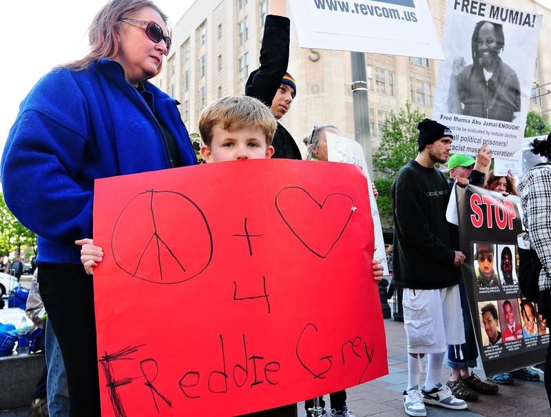 Kingston Howell, 7, joined a Seattle protest in support of Freddie Gray, a black man from Baltimore who died of injuries sustained in police custody.
