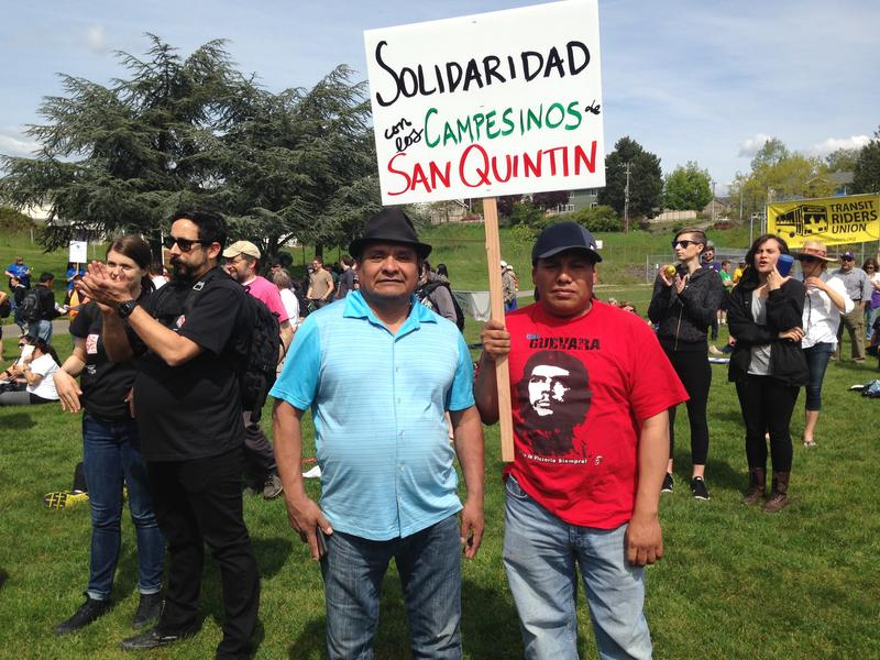 Fidencio Racine (in red) and Salvador Cruz came down from Mount Vernon to attend the immigration rally at Judkins Park on Friday, May 1, 2015.