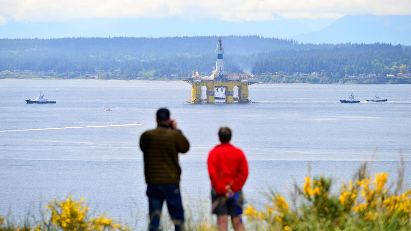John and Linda Beatty of Seattle watch Foss Maritime tugs pull the Polar Pioneer oil rig south past Discovery Park toward the Port of Seattle's Terminal 5 on May 14, 2015.
