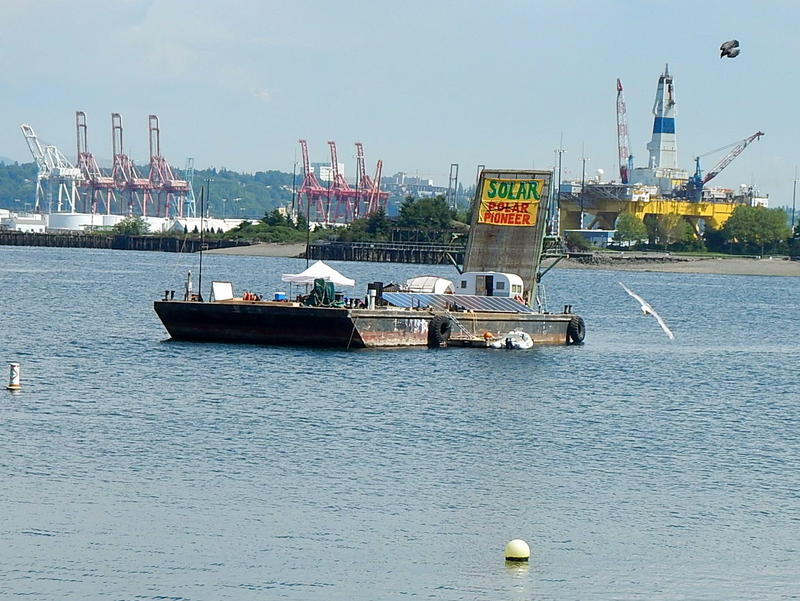Protesters' Solar Pioneer barge in front of Shell's Polar Pioneer drill rig.