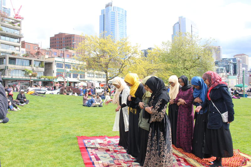 Youth line up for the midday prayer at Victor Steinbreuck Park in downtown Seattle