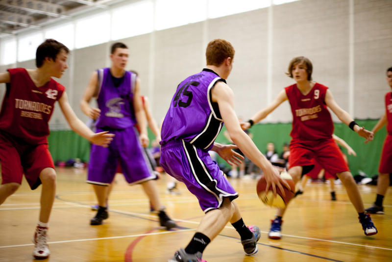 File photo of students playing basketball.
