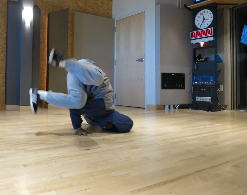 Krubel Amare shows off a head spin in the KUOW studio.