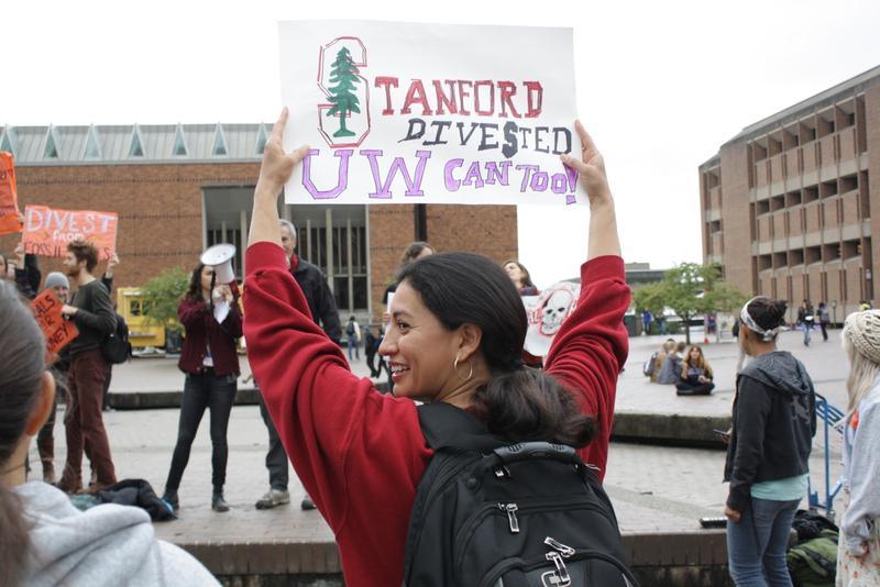 Student Lorena Guillen shows her support for the UW Board of Regents, which on Thursday voted to purge the UW's endowment fund of investments in