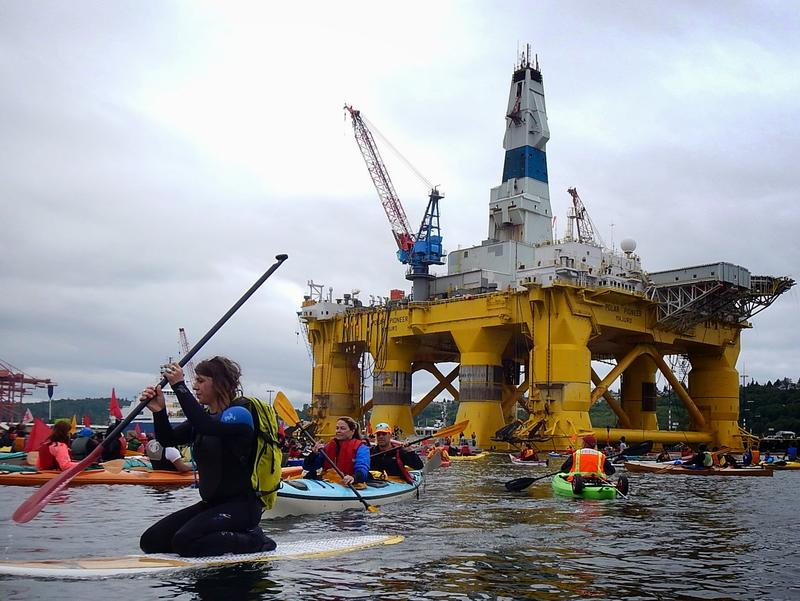 Seattle's planning department is weighing whether to fine Shell, Foss, the local contractor, or the Port of Seattle -- or all three -- for bringing the oil rig to the city.