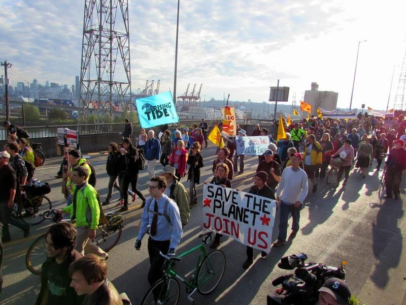 Protesters marched toward Terminal 5 at the Port of Seattle on Monday, aiming to keep workers from entering the terminal.