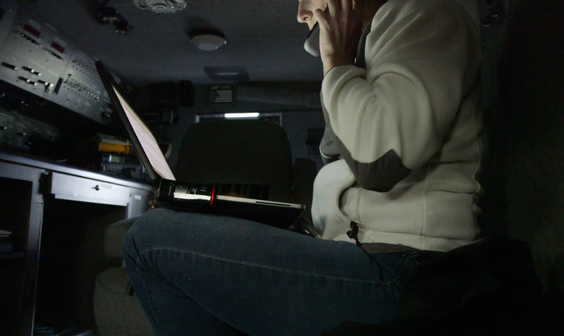 Detective Wendy Willette of Washington's Department of Fish and Wildlife in the police van. Willette heads an operation to unravel a shellfish black market that has sprung up in South Puget Sound.