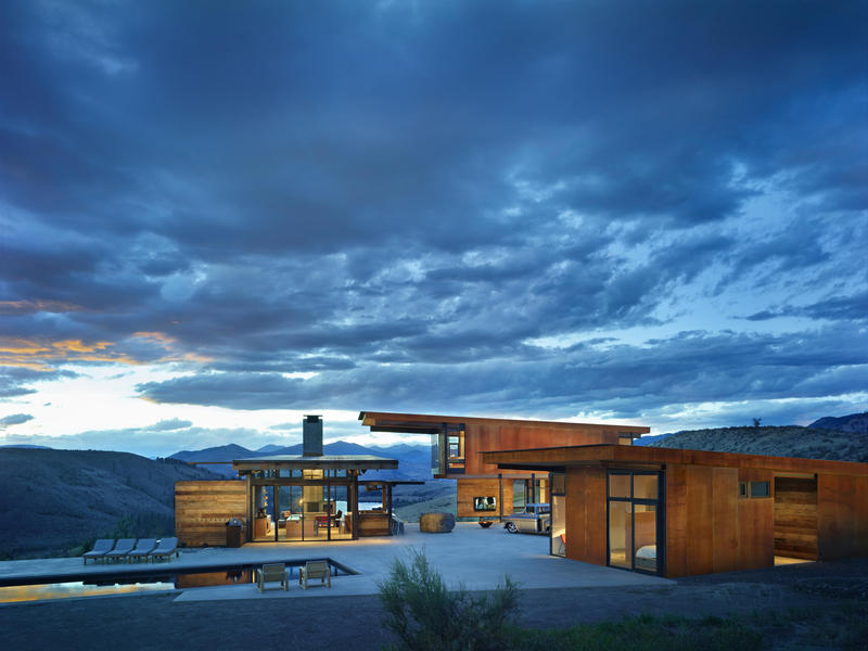Studhorse is the name of this Methow Valley home in Central Washington state. Here, compact living pavilions surround outdoor living spaces.