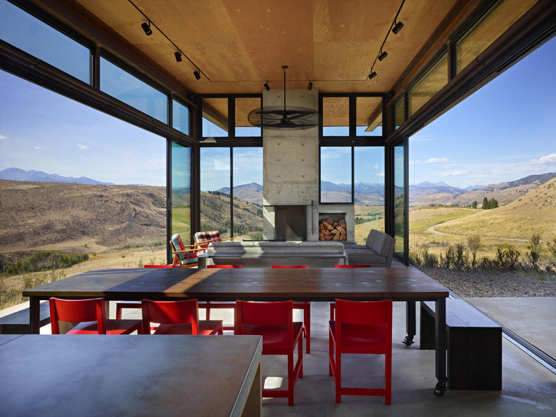 Studhorse. Large window walls open to physically connect living/dining areas to the outdoors.