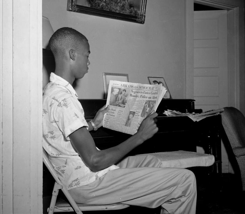 Terrence Roberts is shown at age 15 on Sept. 22, 1957, reading a newspaper after trying to enter all-white Central High School in Little Rock, Ark. He was turned away but tried again the next day.