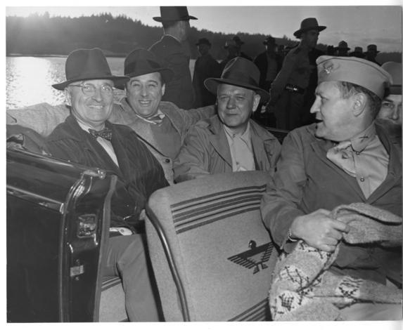 President Harry S. Truman goes for a car ride during a Puget Sound fishing trip. From left to right, Truman, Sen. Warren G. Magnuson, Gov. Monrad C. Wallgren, and Maj. Gen. Harry H. Vaughan.