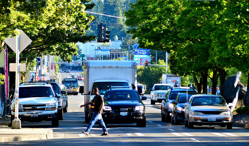 A pedestrian crosses Lake City Way near Northeast 125th Street in Seattle's City Council District 5.