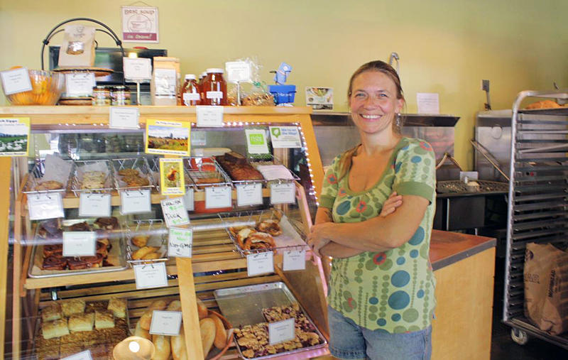 Annette Heide-Jessen's Kaffeeklatsch coffee shop has bet on Lake City Way. A big garage door opens right onto the state highway, which doubles as Lake City's 'main street.' Heide-Jessen sees Lake City as 'the next Columbia City.'