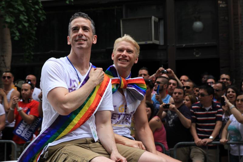 Dan Savage and husband Terry Miller are seen in a 2011 photo.