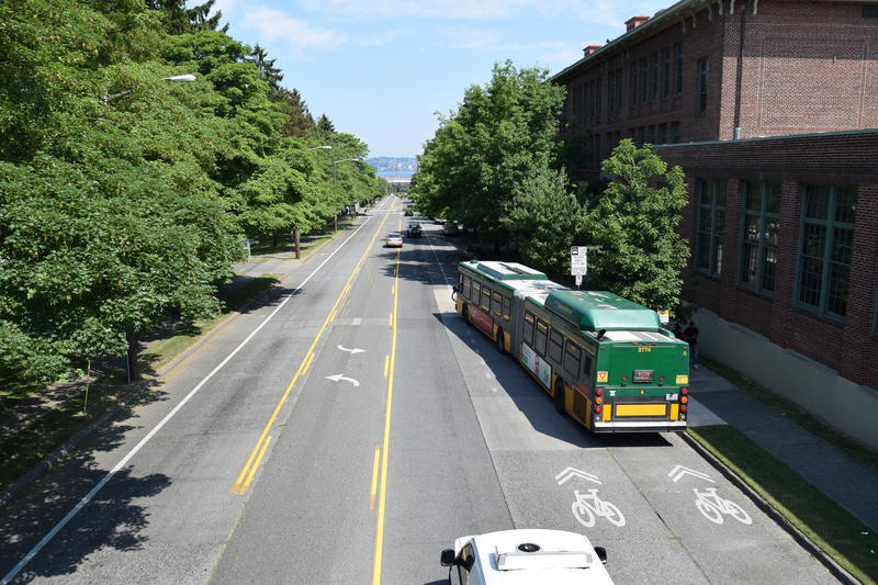 A bus moves into traffic on Delridge Way in West Seattle.