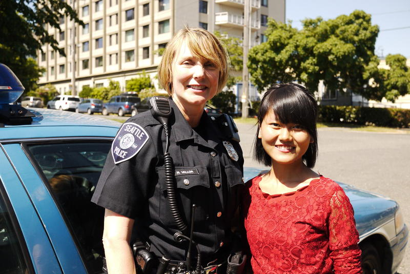 Officer Michelle Vallor and community leader Vung It.