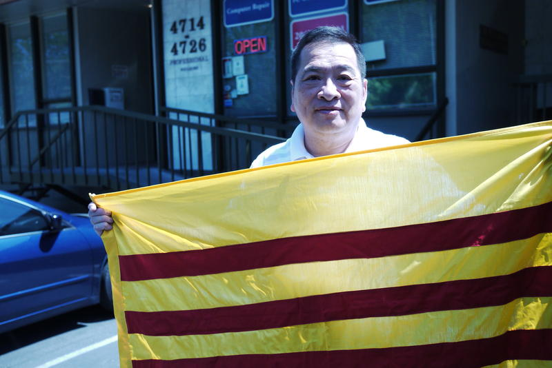 Kim-Long Nguyen displays the national flag of Vietnam prior to the war.