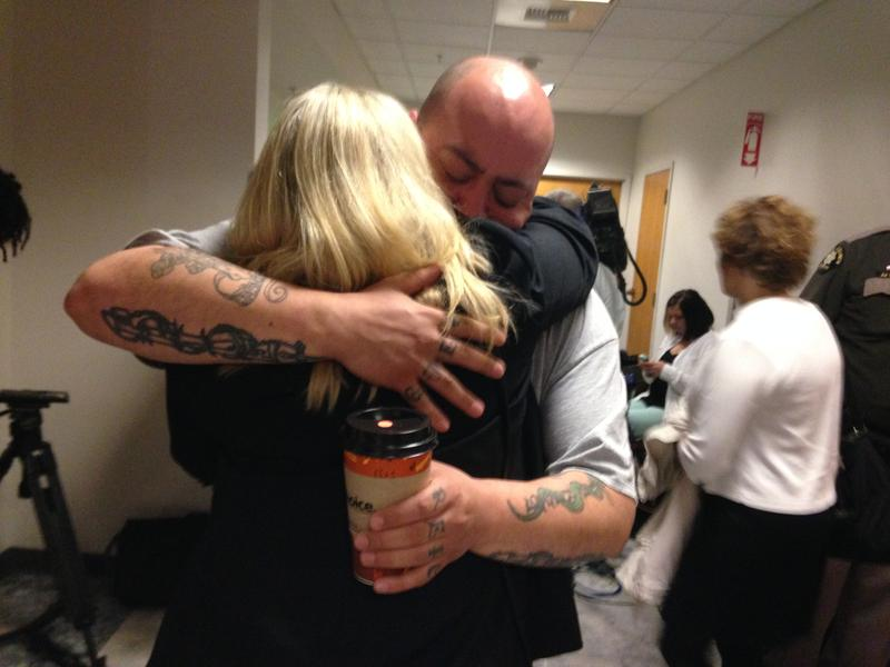 Officer Timothy Brenton's brother and stepmother embrace at the King County Courthouse following the guilty verdict of Christopher Monfort. Monfort was found guilty of mudering Brenton while he was sitting in his patrol car in 2009.
