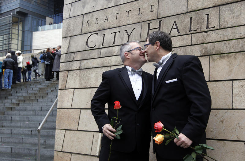 Terry Gilbert, left, kisses his husband Paul Beppler after wedding at Seattle City Hall, becoming among the first gay couples to legally wed in the state, Sunday, Dec. 9, 2012, in Seattle.