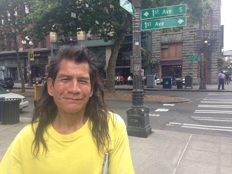 Robert Surles sells Real Change, Seattle's homeless paper, at First Avenue and Yesler Way.