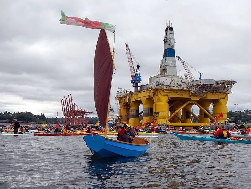 As the energy giant Shell moves floating drill rigs from shipyards in Asia to Alaska's north coast, hundreds of kayakers took to the water in a flotilla of protest.