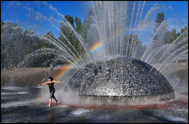 Staying cool in the International Fountain at Seattle Center is one way to beat the heat.