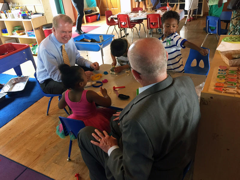 Seattle Mayor Ed Murray and City Councilmember Tim Burgess chat over playdough with preschoolers at Causey's Learning Center, one of the first Seattle Preschool Program providers.