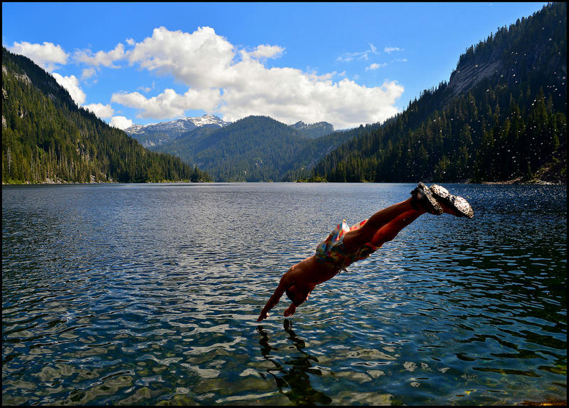 A swimmer dives into Lake Dorothy in eastern King County on a hot July day in 2013.