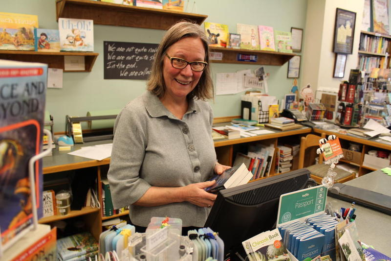 "Christy McDanold owns the Secret Garden Bookstore on Northwest Market Street. She bought her home in Ballard 20 years ago. Today, she says, she couldn't afford the house she lives in. ""I couldn't afford a condo in Ballard today,"" she said."