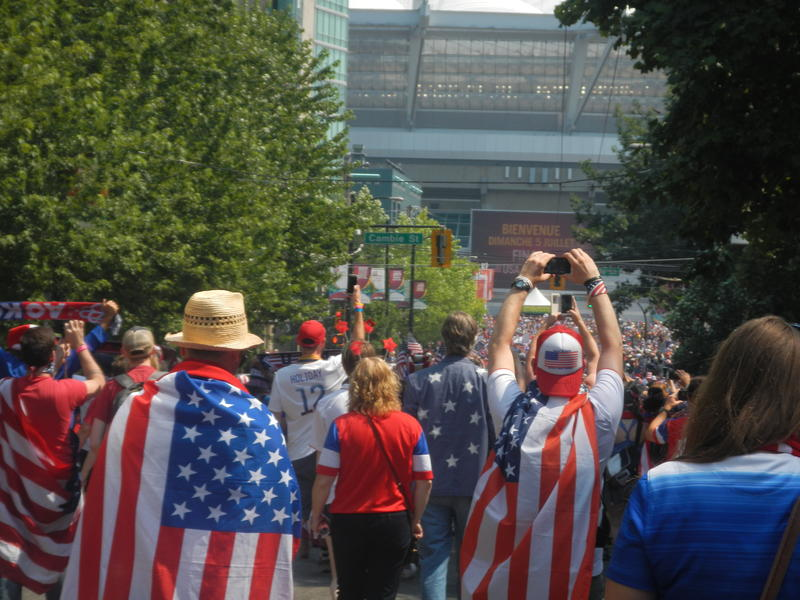 American fans march fill the street as they march to the final match at BC Place.