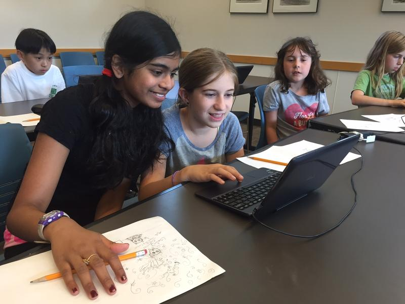Eleven-year-olds Ahana Roy and Lucy Thackray in a video game coding class at Seattle Public Library's Northeast Branch.