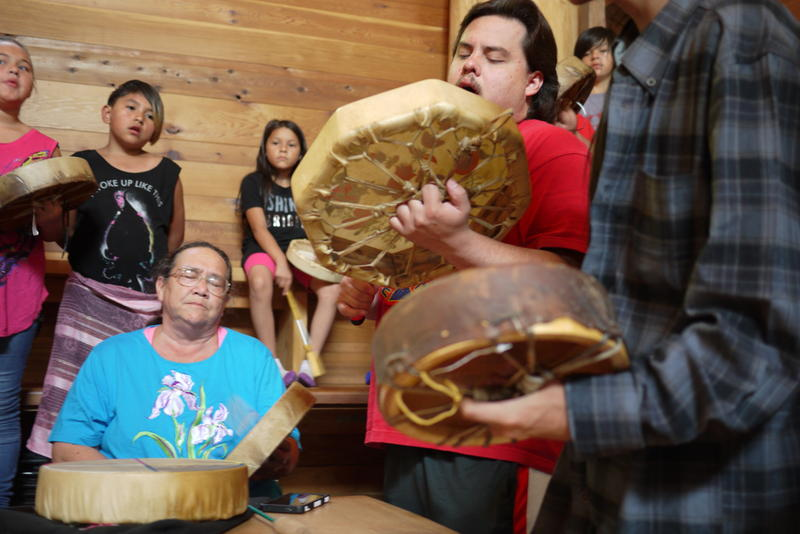Members of the Ojibwe and other tribes play a tribute to honor the Duwamish.