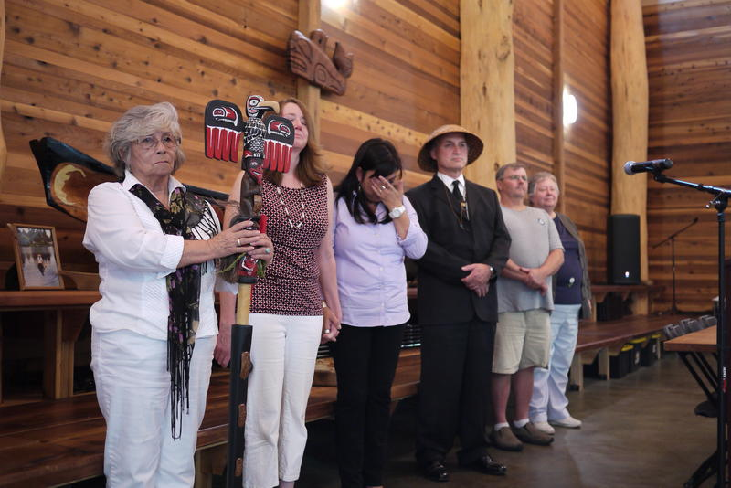 Duwamish Chairwoman Cecile Hansen, left, stands with family and supporters at the tribe's longhouse.