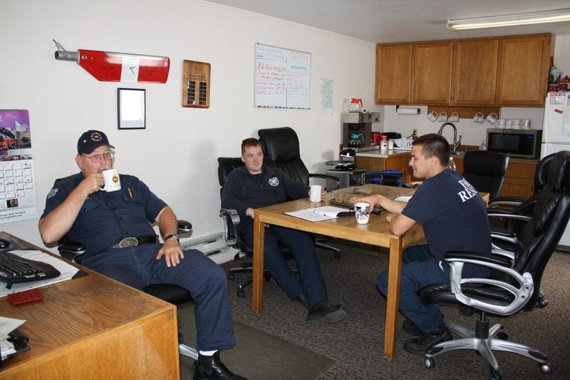 Skykomish Fire Department volunteers Michael Janasz, Nathan Solberg and Mike Baus. The job can mean waiting around for a call. But when a call does come in, Fire Chief Knisley says you can forget about coming home to dinner on time.