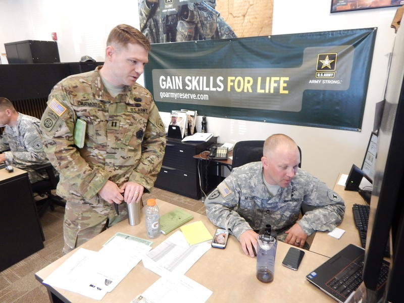 Army Captain Kellam Carmody discusses a recruit's aptitiude test with Army recruiter Kevin Mitchell at the Army Career Center in Tukwila, Washington.