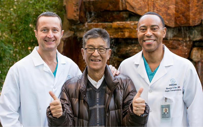 Don Eliget, a patient at Swedish Hospital in Seattle, with transplant surgeons, Drs. Andrew Precht and Marquis Hart.