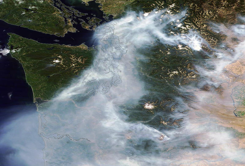 A NASA satellite image shows smoke covering the Puget Sound region on Saturday, Aug. 22. 2015. This image was produced with data from NASA's Moderate Resolution Imaging Spectroradiometer, or MODIS, flown on the Terra and Aqua satellites.