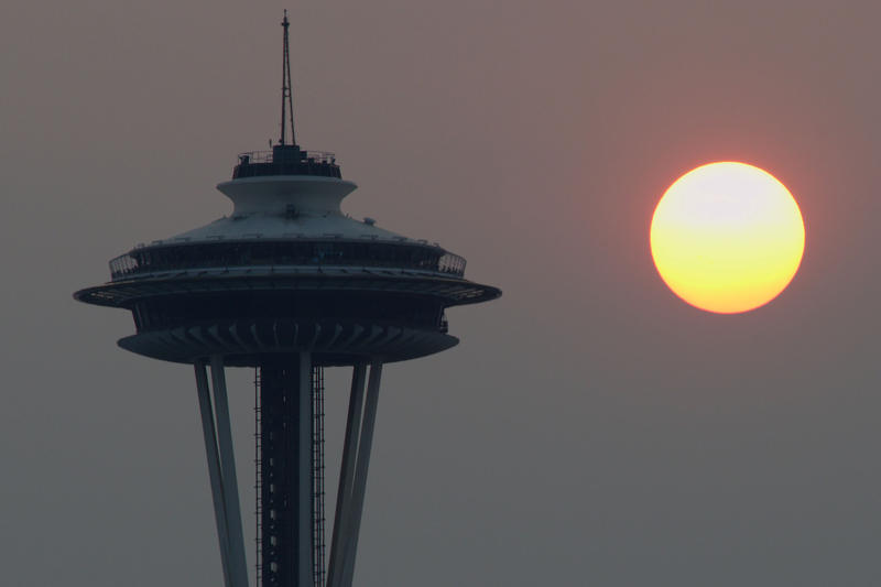 Smoke fills the horizon over Seattle, contributing to a hazy sunset on Saturday, Aug. 22, 2015.