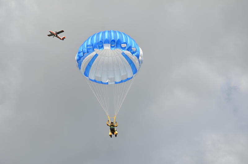 A smokejumper floats down in an image from the U.S. Forest Service.