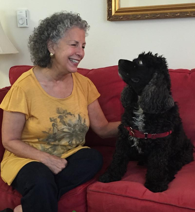 Myriam Marquez at her apartment with her cocker spaniel, Joe Cocker.