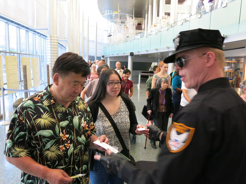 Bill Tashima and niece Katie Cunningham get processed to enter McCaw Hall.
