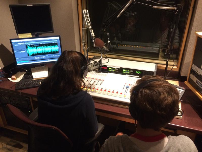Julia Furukawa and Jack Paradise record a phone interview for this podcast in the KUOW studios.