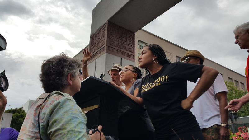 Activists from the Seattle chapter of Black Lives Matter took over the stage at a rally for Vermont Sen. Bernie Sanders on Sat., Aug 8, 2015. They called for four minutes of silence, and Sanders left the stage to greet those who had come to see him.