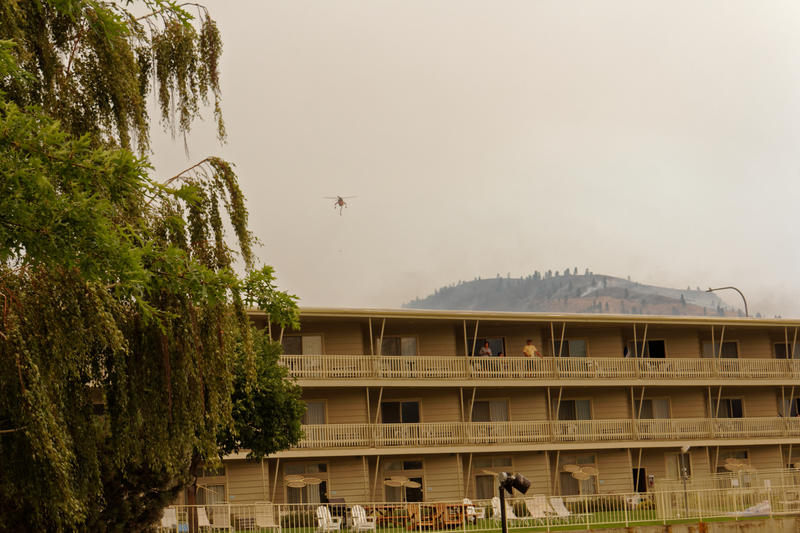 The next day, Saturday, Aug. 15, the smoke descended on Campbell's Resort in Chelan, Washington. Many families decided to leave. Photographer Ben Brooks, whose family has been coming here since 1984, decided to stay.