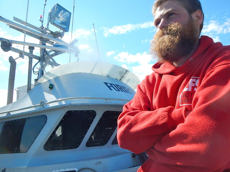 Mihey Basargin of Wasilla on the docks in Dutch Harbor after being rescued.